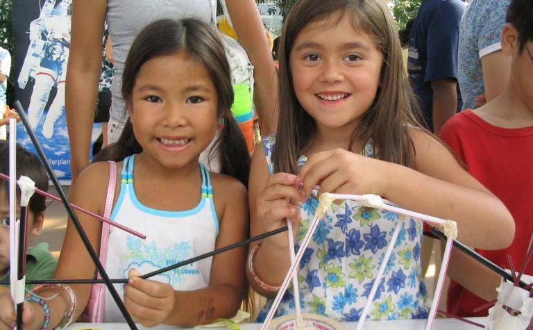 The Science Olympiad Straw Towers activity engaged students and families during a neighborhood Science in the City event, where they were challenged to build the tallest structure capable of holding a tennis ball for three seconds.  More than 5,000 people and all 604 Chicago Public Schools participated in the Straw Tower Challenge in 2007.